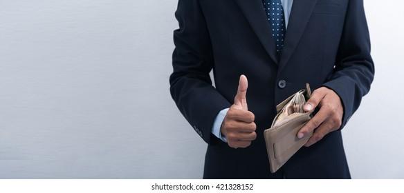 businessman show Thai money in the wallet.