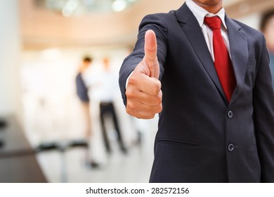 businessman show thumb up in office