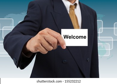 Businessman show a white card with word Welcome