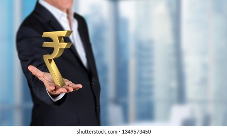 businessman showing 3D render indian rupee symbol  on his hand in a office. Skycrapers are in background.