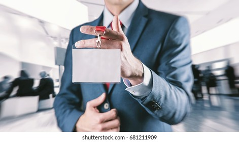 Businessman showing a blank identity name card at a exhibition