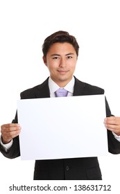 Businessman showing a blank paper wearing a suit and tie. White background.