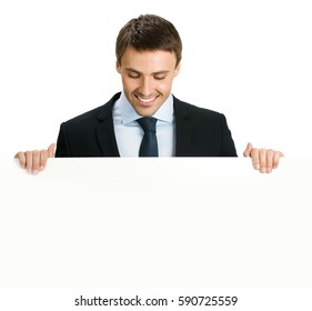 Businessman showing blank signboard, isolated against white background. Empty copyspace area for slogan or advertising text message. Success in business, job and education concept studio shot.