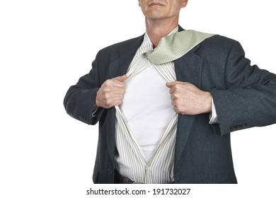 Businessman showing blank superhero suit underneath his shirt standing against city white background
