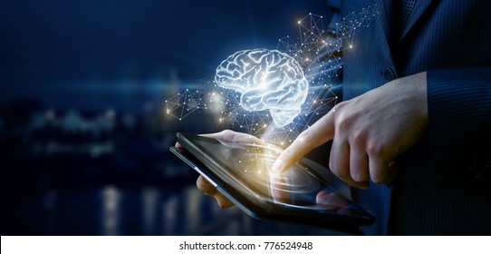 Businessman showing a brain on blurred background. The concept of brainstorming in the network.