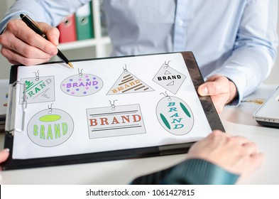 Businessman showing brand concept on a clipboard