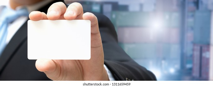 Businessman showing a business card, Card in the hand for insert contract text and Coordinate about logistic business.