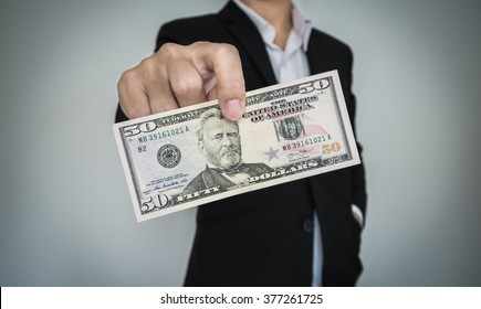 Businessman showing cash, for tipping and etc.