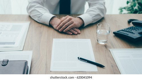 Businessman showing a contract to the customer before signing it, agreement and partnership concept