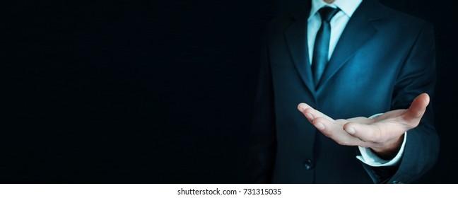 Businessman showing empty hand.