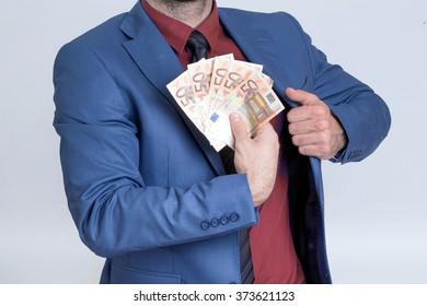 Businessman showing euro bills