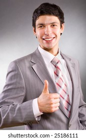 Businessman showing everything is OK
