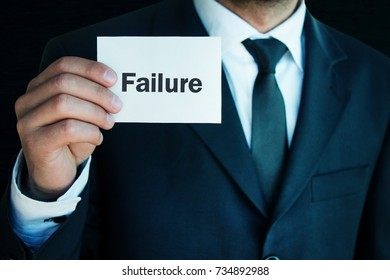 Businessman showing failure text.
