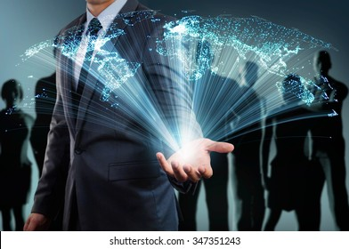 businessman showing global connection with business people on background