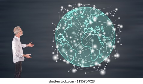 Businessman showing a global connection concept on a wall screen