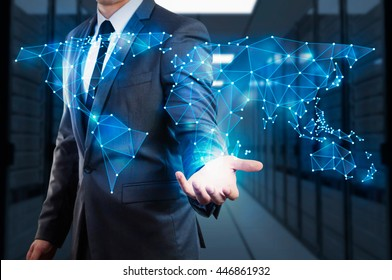 businessman showing  global network mesh with server room background