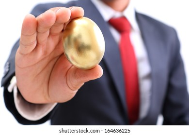 businessman showing the golden egg