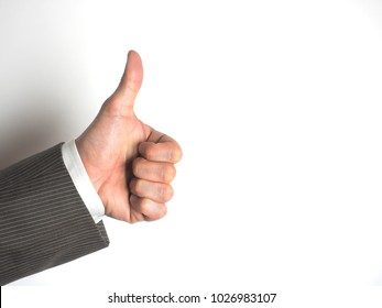 A businessman showing a good sign with a thumb