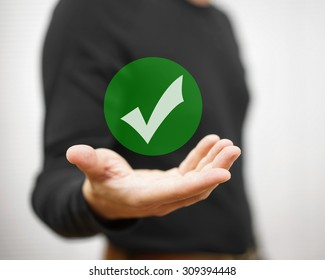 Businessman showing green check mark. Concept of correct decision