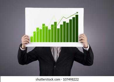 Businessman showing a green graphic of his business growth. shot in studio