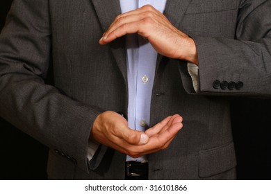 Businessman showing with the hands. Business concept