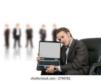 businessman is showing his blank laptop screen for your text or graphic to put in