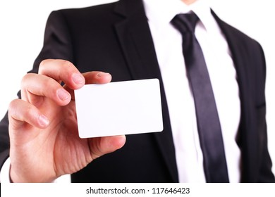 Businessman showing his business card. You can just add your text there.
