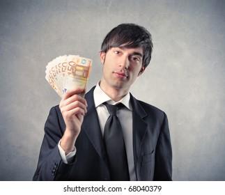 businessman showing his money