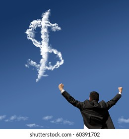 businessman showing his success at the field looking to a dollar symbol made of clouds
