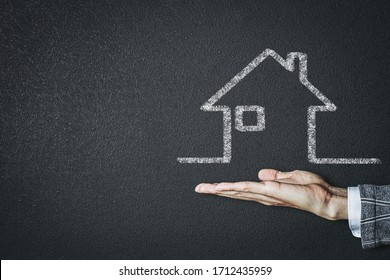 Businessman showing house on hands