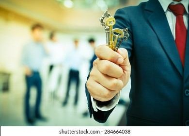 businessman showing the keys to success