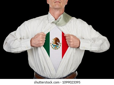 Businessman showing Mexico flag superhero suit underneath his shirt standing against black background