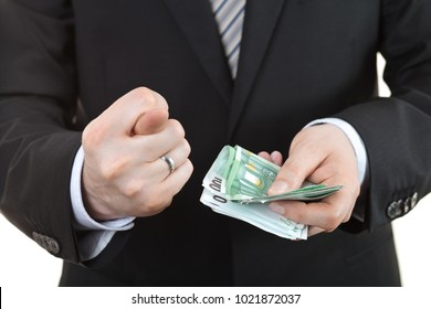 Businessman showing nothing sign and holding euros money