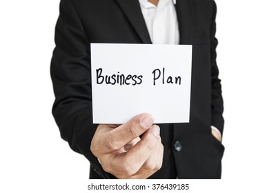 """Businessman showing paper note with the word """"Business Plan"""", isolated on white background"""