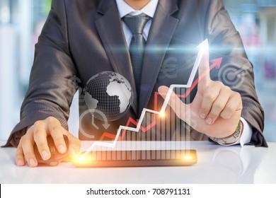 Businessman showing profit growth on virtual screen.