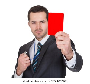 Businessman showing red card. Isolated on white