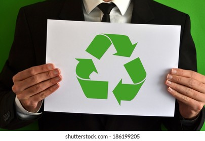 Businessman showing a sheet with the recycling symbol