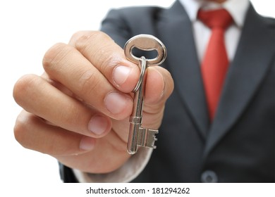 businessman showing the silver key to success isolate on white clipping path