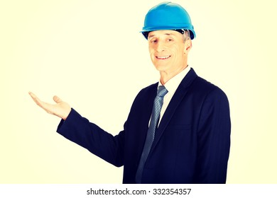 Constructor businessman showing something invisible.