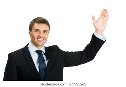 Businessman showing something, isolated over white background. Copyspace area for slogan or advertising text message. Success in business, job and education concept studio shot.