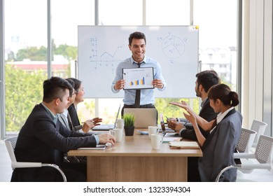 businessman showing success business profit graph in meeting with smile and happy face