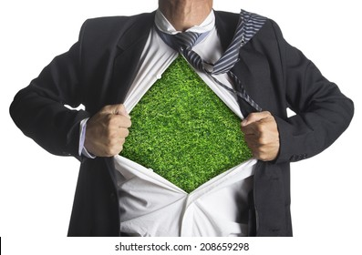 Businessman showing a superhero suit underneath green grass texture, isolated on white background