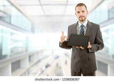 businessman showing a tablet pc, at the office