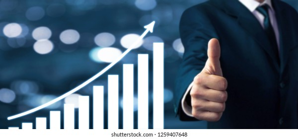 Businessman showing thumbs up sign. Growth graph. Success concept