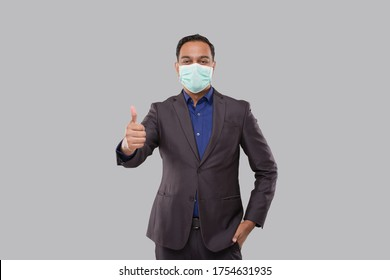Businessman Showing Thump Up Wearing Medical Mask and Gloves Isolated. Indian Business Man Standing Thump Up sign