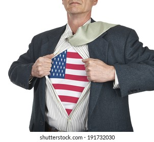 Businessman showing USA flag superhero suit underneath his shirt standing against white background