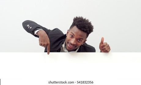 businessman showing white page holding blank board