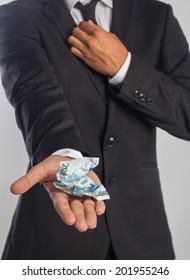 Businessman showing a wrinkled banknote