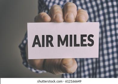 Businessman shows AIR MILES card