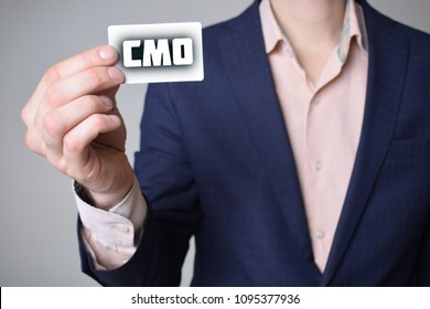Businessman shows business card with the inscription:CMO